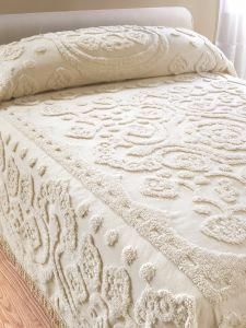 Floral chenille bedspread made of plush cotton with floral center medallion, scallop border, and traditional fringe. Cotton chenille provides all-season comfort.