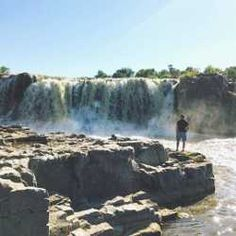Falls Park in the heart of downtown Sioux Falls covers 123 acres and is a top attraction of the city. Falls Park, Autumn Park, Gallon Of Water, Sioux, Niagara Falls, Sd, Acre, Things To Do, Waterfall