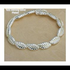 "*NEW* 925 SILVER LEAF BRACELET **NEW**   925 STERLING SILVER PLATED SILVER LEAF BRACELET Colors.           Silver & Gold Length.          7 1/2 - 8"" Clasp.             Double Lock This Beautiful BRACELET has a VERY snug fitting with two Clasp Locks on either side! Doubt very much this will fall off your wrist! Great gift for YOURSELF OR AS a CHRISTMAS GIFT!!?? Jewelry Bracelets"