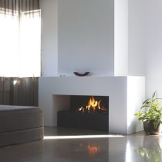 This angular, contemporary wall fireplace gives a modern look to a traditional shape the simple and elegant contemporary wall fireplace design can sit in a modern setting White Fireplace, Modern Fireplace, Fireplace Wall, Fireplace Design, Wall Fireplaces, Indoor Outdoor Fireplaces, Wall Design, House Design, Home Suites