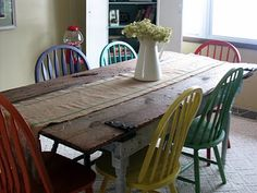 replace table top with old barn wood, paint  distress legs,  paint chairs (I would probably go with all barn red- or maybe 4 red  2 robins egg blue....