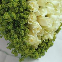 Closeup of creamy white roses and lady' mantle
