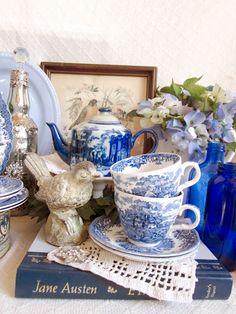 blue vignette, bird,# tea pot, tea cups, books, blue glass bottles