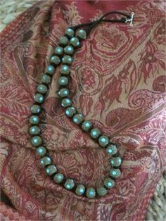 Unusual find in this traditional necklace from theUttar Pradesh region of northern Indiaat the border of Nepal nearthe base of the Himalayas. Colorful textured beads with choice of color accents.