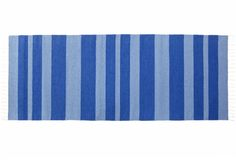 Olle Blue - traditional nordic rug with modern stripes. It's made in Finland with high quality and good taste. Find it online www.viitanordic.com