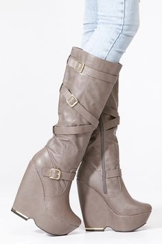 Gotta love a fierce pair of wedge boots for fall! It features a padded insole, almond toe front, gold accent crossed buckles, inner zipper for closure, and platform bottom with gold accent. These pair of chic wedge boots are perfect for a fierce outfit in neutral tones put on your favorite neutral tone leggings and layer your self with a shear top and knit sweater!  See it today at www.cicihot.com #season #hot #beach #pool #poolparty #lake #fashion #fashionista #cicihot #fun #cute #party