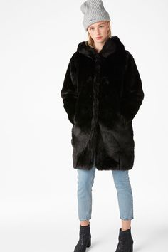 A legendary black faux fur coat with a fur hood - the stuff of winter dreams! Hook and ring closures and a high neck to keep the cold out. In a size small