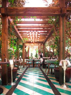 west hollywood cecconi's second outpost at the soho beach house - I think very well designed restaurants do a great job of framing spaces well and leave you with a really strong feeling/impressions. The hard lines of the wood posts (natural material), paired with the colorful diagonal streak of the floors, and the lights dotting the ceiling towards the bag does a phenomenal job of engaging different perspectives. Oh and that color is fantastic.