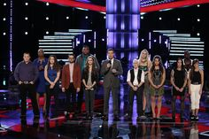 "The Voice - Season 6 -- ""Live Show"" -- Pictured: (l-r) Jake Worthington, Sisaundra Lewis, Audra McLaughlin, Josh Kaufman, T.J. Wilkins, Bria Kelly, Carson Daly, Kristen Merlin, Dani Moz, Tess Boyer, Kat Perkins, Delvin Choice, Christina Gimmie -- (Photo by: Tyler Golden/NBC)"