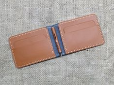 This money clip wallet made in high quality vegetable tanned leather. Wallet has - money clip - 4 credit card slots - 2 pockets See other money clips Slim Wallet, Men Wallet, Money Clip Wallet, Minimalist Wallet, Leather Bifold Wallet, Vegetable Tanned Leather, Wallets For Women, Tan Leather, Hand Stitching