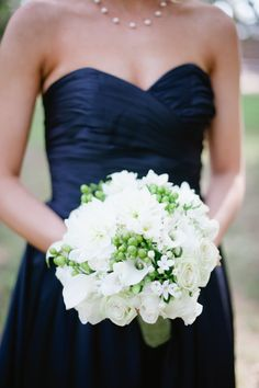 This is a pretty shade of navy.  Navy bridesmaid dress & white and green bouquet.