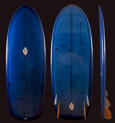 Minisimmons quad 5'4, resin tint and keel fins.