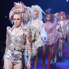 Marc Jacobs's show had glam rockers in kinky boots - From rainbow dreadlocks to 7-inch platform boots, Marc Jacobs' Spring 2017 presentationwas more rave than runway. The designer closed out NYFWwith a bang through a fresh change from the wearable clothes and minimalist aestheticswe saw atother shows. Models flaunted camouflage prints and pink hot pants under twinkling light bulbs that hung from the ceiling of the Hammerstein Ballroom. Both futuristic and telling of the times…