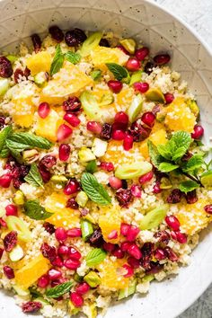Close up of a quick and easy orange pistachio pomegranate couscous salad recipe ready in less than 15 mins. A colourful vegan and vegetarian side dish – recipesfromapantry.com #couscous #couscoussalad #easycouscous #christmasrecipe #howtomakecouscoussalad #vegetariancouscous #moroccancouscous
