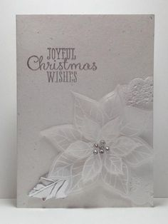 Joyful Christmas, su!, embossed it in white, then cut out, silver foil for leaves, embossed sentiment in pewter ...