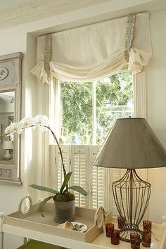 This is what I want to make for my kitchen/dining window treatments. These are called Butterfly Swags! Envision the main fabric itself done in a burlap with contrasting bands done in grosgrain ribbon....a fixed window treatment that does not need to be adjusted. I would include either pleated shades or mini blinds beneath the panels. A bit casual but different!