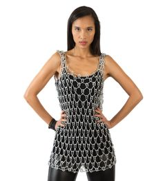 Loose crochet diamond-pattern. Lightweight metallic cover-up for partying or beach. Fits up to size six Thread color: silver only