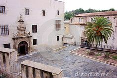 Photo about A beautiful plaza in a Mediterranean town in Spain with a decorative entry and palm tree. Image of entry, spanish, palm - 80158930 Travel Europe, Palm Trees, Spanish, France, Stock Photos, Mansions, House Styles, Image, Beautiful