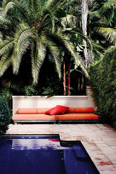 Orange daybed in outdoor space #splendidspaces