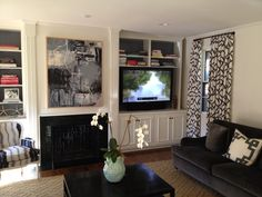 """Living Room 50"""" Display on an articulating mount with sound bar."""