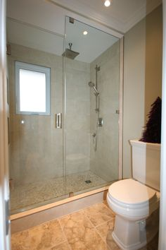 transformation from a small space with just a toilet and tub area, we were able to create a large 5' shower area, new position for the toilet, added a fan and more lighting and a pocket door for privacy