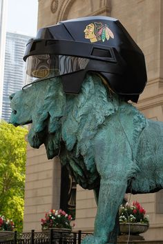 A lion sculpture sports a Chicago Blackhawks helmet in celebration of the Blackhawks appearence in the Stanley Cup Finals against the Philadelphia Fylers at the Art Institue of Chicago on May 26, 2010 in Chicago, Illinois. The lion sculptures, by artist Edward L. Kemeys, were installed at the Michigan Avenue entrance to the museum in 1894.