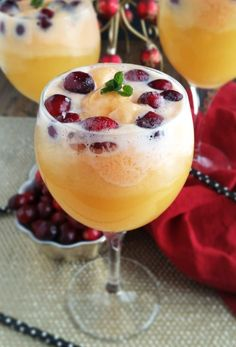 Orange Cranberry Mimosa Floats are so beautiful and festive for the holiday season! Just use your favorite bottle of champagne, add some cranberries, orange sherbert and a dash of cranberry juice. There is no reason to limit yourself .have one for brunc Christmas Brunch, Christmas Drinks, Holiday Drinks, Summer Drinks, Fun Drinks, Holiday Recipes, Beverages, Floats Drinks, Recipes For Brunch