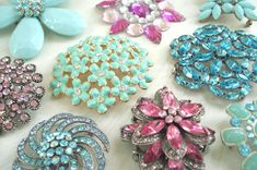 vintage brooches,my gramma never left the house with out one pinned on her dress.With the exception of one,these look like many of hers,