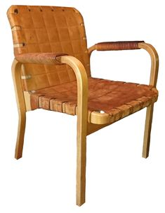 This is a super example of the furniture of Alvar Aalto of Finland.   This armchair in steam bent laminated birch with a leather seat and back, and with leather bound arms, dates to the early part of the 1960s and has been in one family since new. The chair has been used but not abused and the birch and leather each show the rich patina of age and use. Note the seat is solid leather and not woven, rather, it has a quilted look embossed, givi...