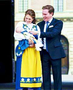 myroyalpointofview:   Chris O'Neil and Princess Madeleine of Sweden with Princess Leonore making her first appearance in national dress, Swedish National Day, June 6, 2014