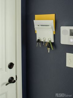 Whether you are into DIYing or buying, this post has the perfect winter solutions for those of us with small entryways. We've got a tiny square foot) garage entryway with doors on three of Key Organizer, Organizers, Garage Entryway, Peg Hooks, Diy Coat Rack, Small Entryways, White Spray Paint, Entryway Organization, Organizing Your Home