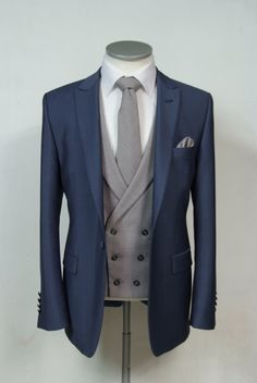 he newest collection to our hire ranges is this Steel blue wool & mohair slim fit grooms wedding lounge suit available from stock from July 2015 shown here with a grey cdouble breasted wool waistcoat matching tie & pocket square. Complete outfit available to hire for £159.50 #wedding #suit #groomsuit #groomstyle #groom #waistcoat #steelblue