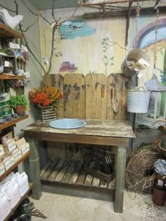 """RECLAIMED WOOD POTTING BENCH - """"I built this potting bench from reclaimed chippy fence boards that were a light pink color tung and groove siding with chippy white paint white chippy pickets and blue posts. I scraped sanded and waxed all the pieces t Potting Tables, Potting Soil, Old Fence Boards, Outdoor Sinks, Old Fences, Wood Post, Light Pink Color, Building A Shed, Pottery Studio"""
