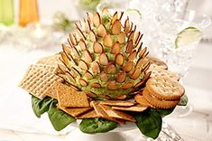 Enjoy winter flavors with the nutty RITZ Crackers Pinecone Cheese Spread.