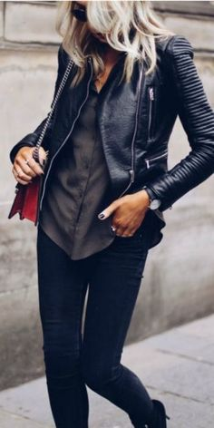 Lucy Connelly + leather jacket + simple + silky button down shirt + black jeans + minimal accessories + stripped-back style + perfect for everyday wear.   Brands not specified.