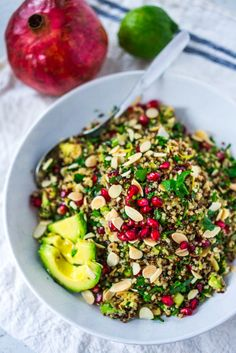 A delicious recipe for Holiday Crunch Salad with Quinoa, Pomegranate seeds, toasted almonds, avocado, and parsley. Vegan and Gluten-free!