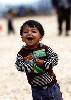 Happy smile from a little Syrian kid in a refugee camp. Turkey.