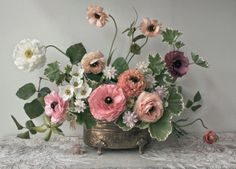 Bouquet by Ariel Dearie, on one of the most beautiful embroidered linen table clothes...