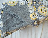 Charcoal minky baby blanket in gray with bright yellow and light gray flowers