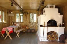 A Swiss chalet kitchen with a huge log-burning oven. #homeandstyleliving
