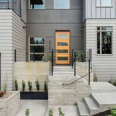 Entry from our latest project, features custom steel handrails, siding, windows and board formed concrete. Exterior Stairs, House Paint Exterior, Exterior House Colors, Concrete Stairs, Board Formed Concrete, House Siding, Facade House, Modern Exterior, Exterior Design