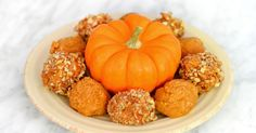 These easy pumpkin peanut butter balls are the perfect unprocessed treat.....maybe date syrup instead of maple syrup.