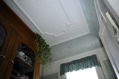 Curved ceiling tile
