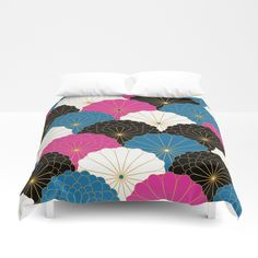 Duvet cover with traditional japanese chrysanthemum flower pattern in purple, black, blue and white.
