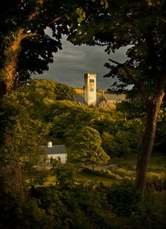 """Evensong by Mal Smith, via - """"Stormy evening light on Manorbier Church in Pembrokeshire, South Wales, UK"""" - The light gives its benediction to the valley at peace. Oh The Places You'll Go, Places To Visit, Norman Castle, Pembrokeshire Wales, Celtic Nations, South Wales, Wales Uk, British Isles, Great Britain"""