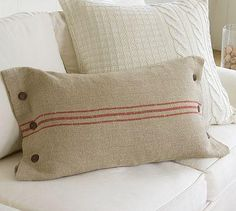 accent pillow matching grain sack drapes. could use tea towels or other fabrics for these.