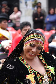 """Dancing at the La Paz """"Gran Poder 2011"""". The Feast of Jesus of the Great Power is a religious holiday celebrated in the city of La Paz, Bolivia. The dramatic festival features thousands of dancers parading down the sprawling streets of La Paz, flaunting their colorful costumes while thousands of spectators cheer in delight.                                                                                         Flickr - Photo Sharing!"""