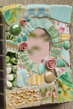 Vicki's thought:  mosaic mirror...I love this!  I want a bigger one for my bathroom.