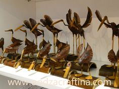 They are so beautiful and alive...wooden sculpture