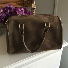 Fashionable like-suede handbag Never used. Brownish with gold zipper. Can be handbag, also comes with strap to make a cross body. Great shape. Comment for more pics/questions. Francesca's Collections Bags